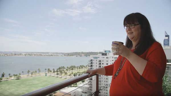 Sue-anne enjoying a coffee on her balcony